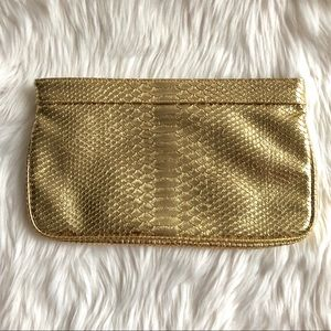 GUESS NWOT Gold Snake Textured leather clutch